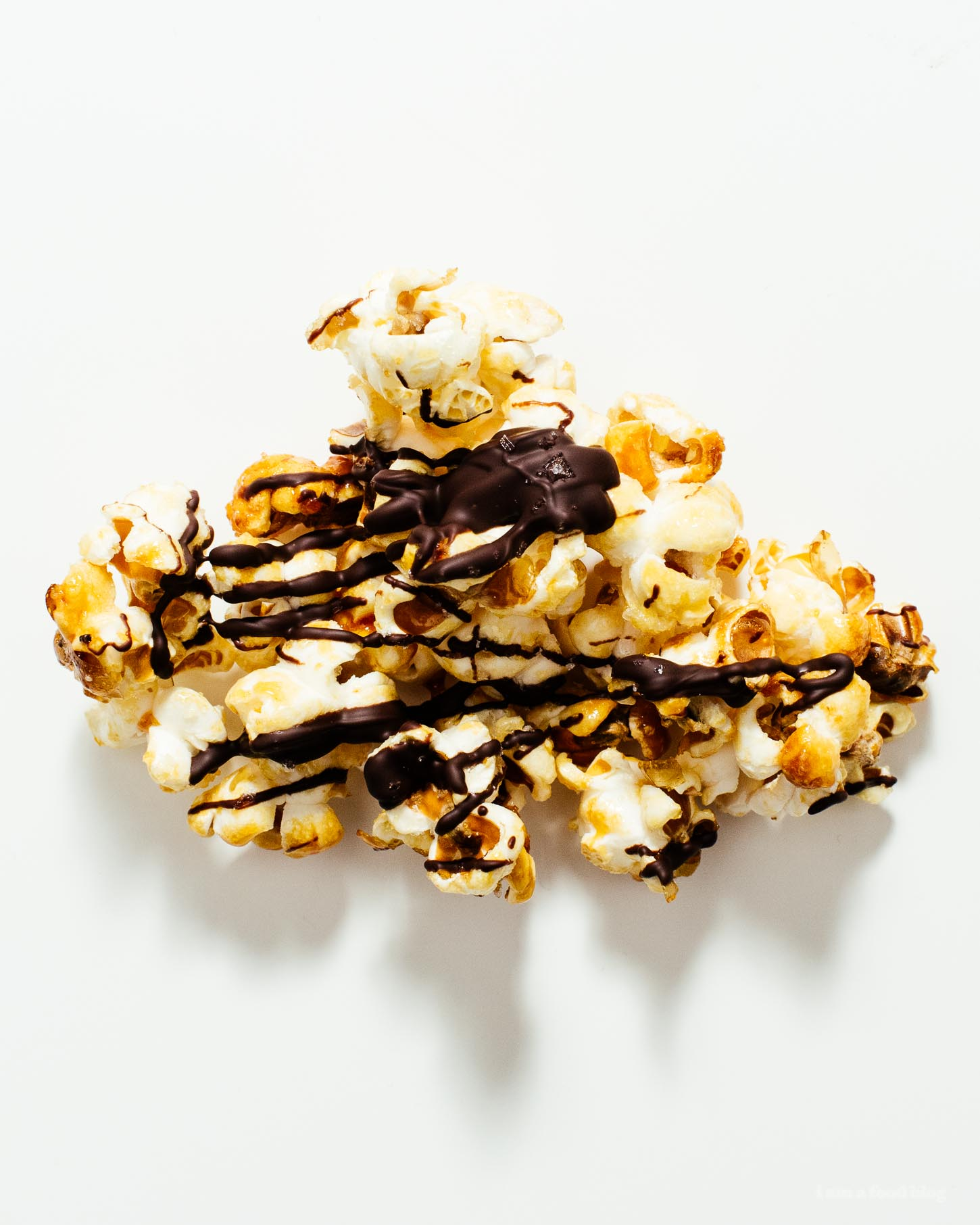 Dark Chocolatey Drizzled Flaky Sea Salt Kettle Corn | www.iamafoodblog.com