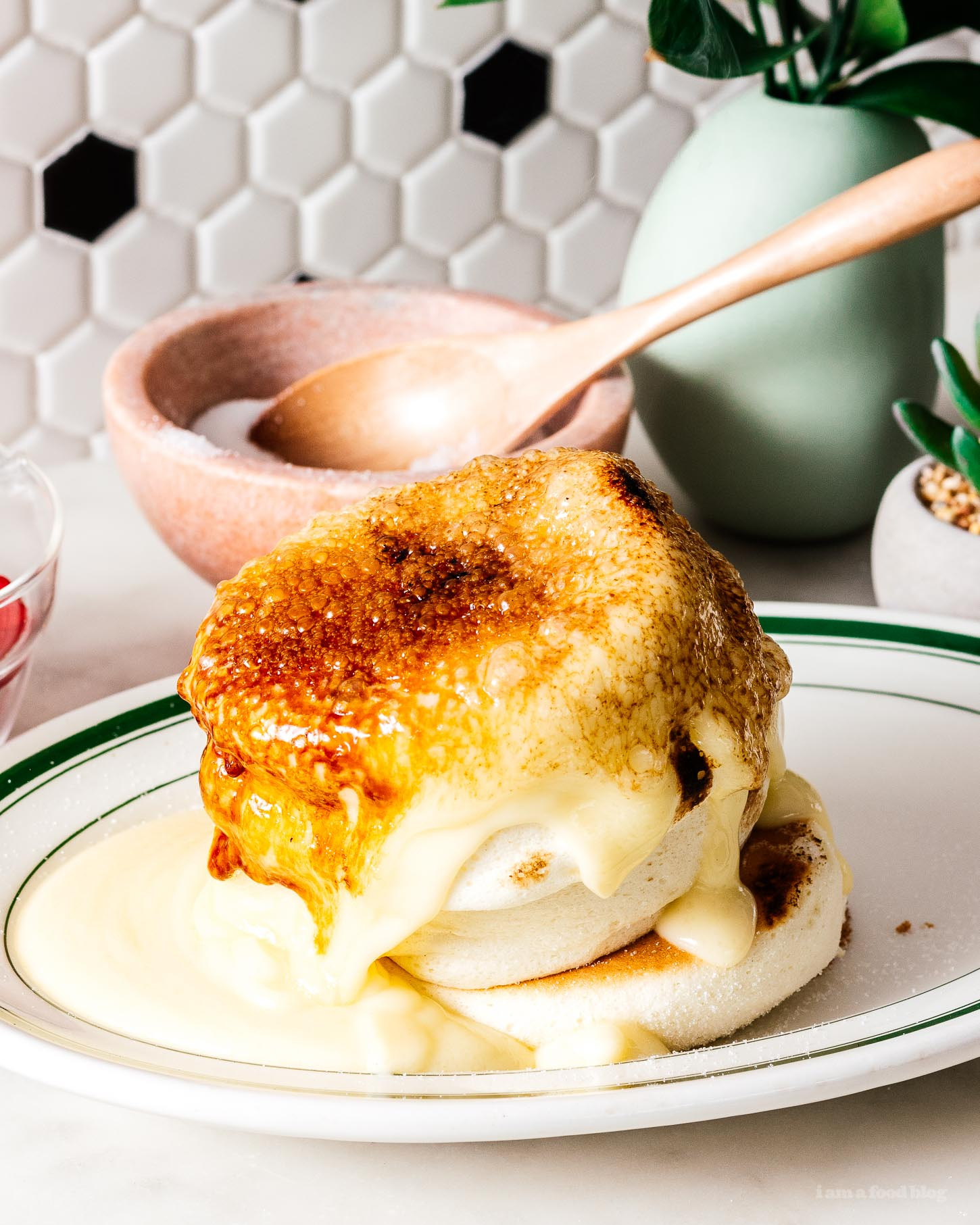 Do you want to eat fluffy Japanese soufflé creme brûlée pancakes but don't want to fly to Hong Kong or wait in a line for hours? This recipe is for you! Make the fluffy pancakes of your dreams, tall and fluffy with a creme brûlée crackling sugar crust. #pancakes #japanesepancakes #soufflepancakes #recipes #brunch