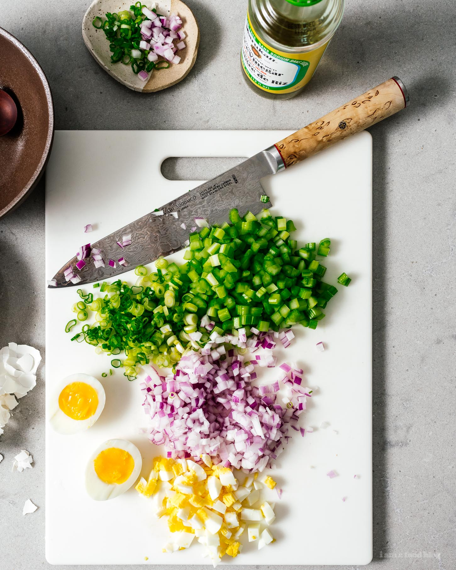 Make this classic perfect picnic potato salad and bring it to ever summer gathering! Creamy potatoes, crunchy celery, onions, and eggs combine into a salad you'll be making and eating over and over again thanks to a secret ingredient: rice vinegar for tang. #potatosalad #potatoes #recipes #potatosaladrecipe