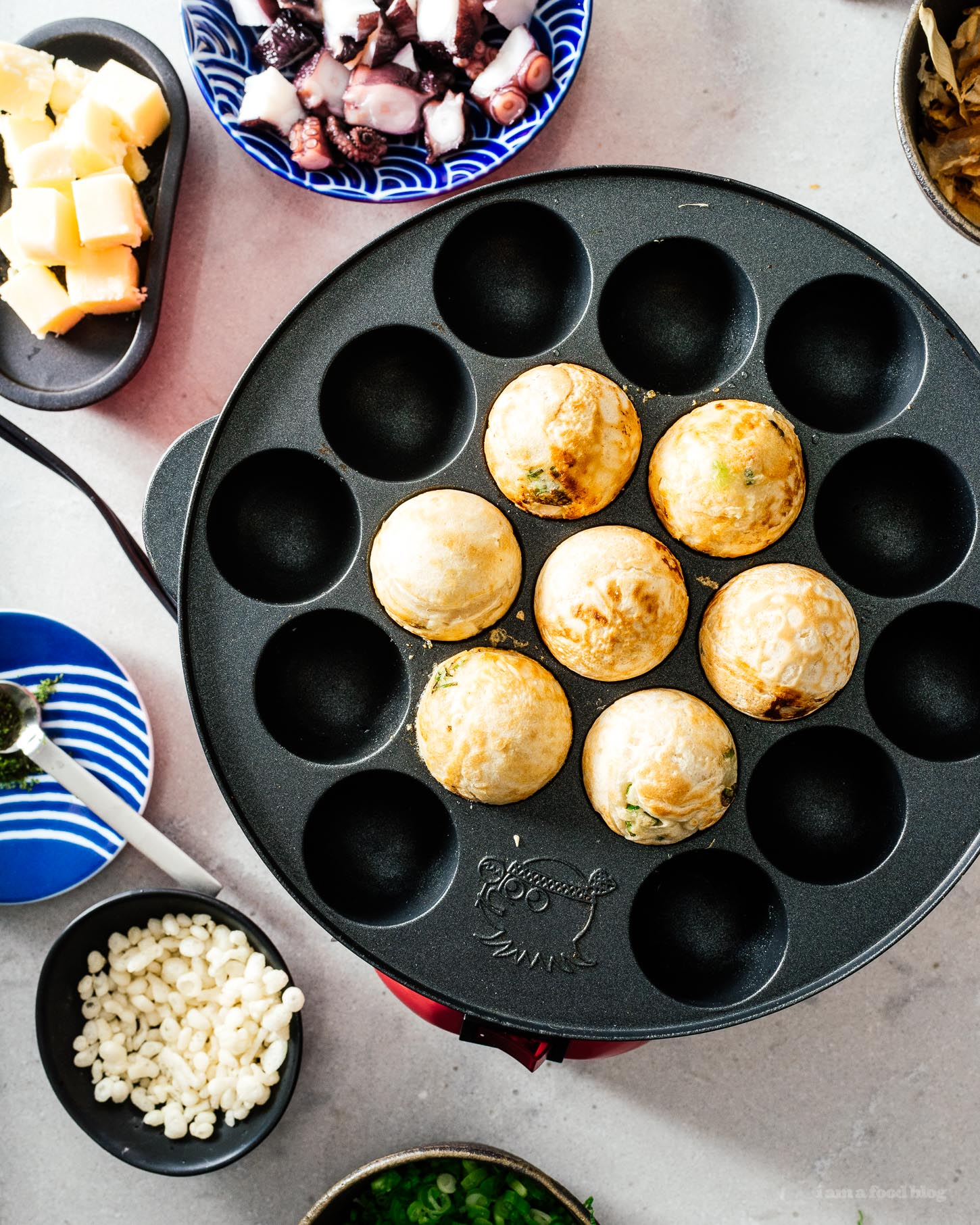 Throw a Japanese takoyaki dinner party with this takoyaki, the ultimate Japanese street food at the table with friends and family. Interactive, fun, and delicious! Authentic takoyaki recipe #japanesefood #recipes #takoyaki #streetfood #japan #tokyo #howto