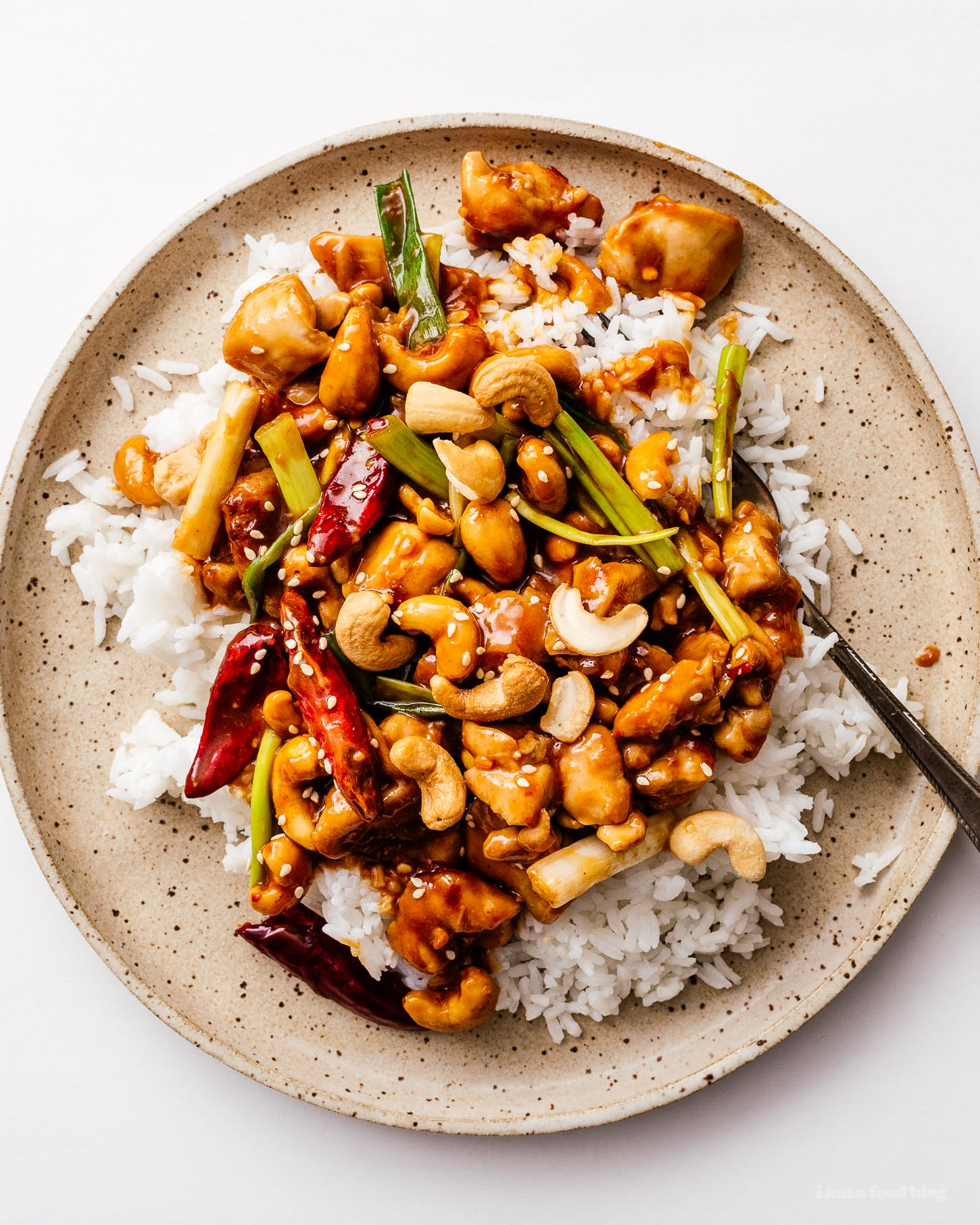 This spicy, tangy, sweet, and addictive better than takeout no peanut kung pao chicken stir fry recipe is here to brighten up your weeknight (or weekend) dinners! Highly addictive and super easy to make at home. #recipe #recipes #dinner #kungpao #kungpaorecipe #kungpaochicken #kungpaochickenrecipe #takeout #takeoutrecipes #betterthantakeout #stirfry #stirfryrecipes