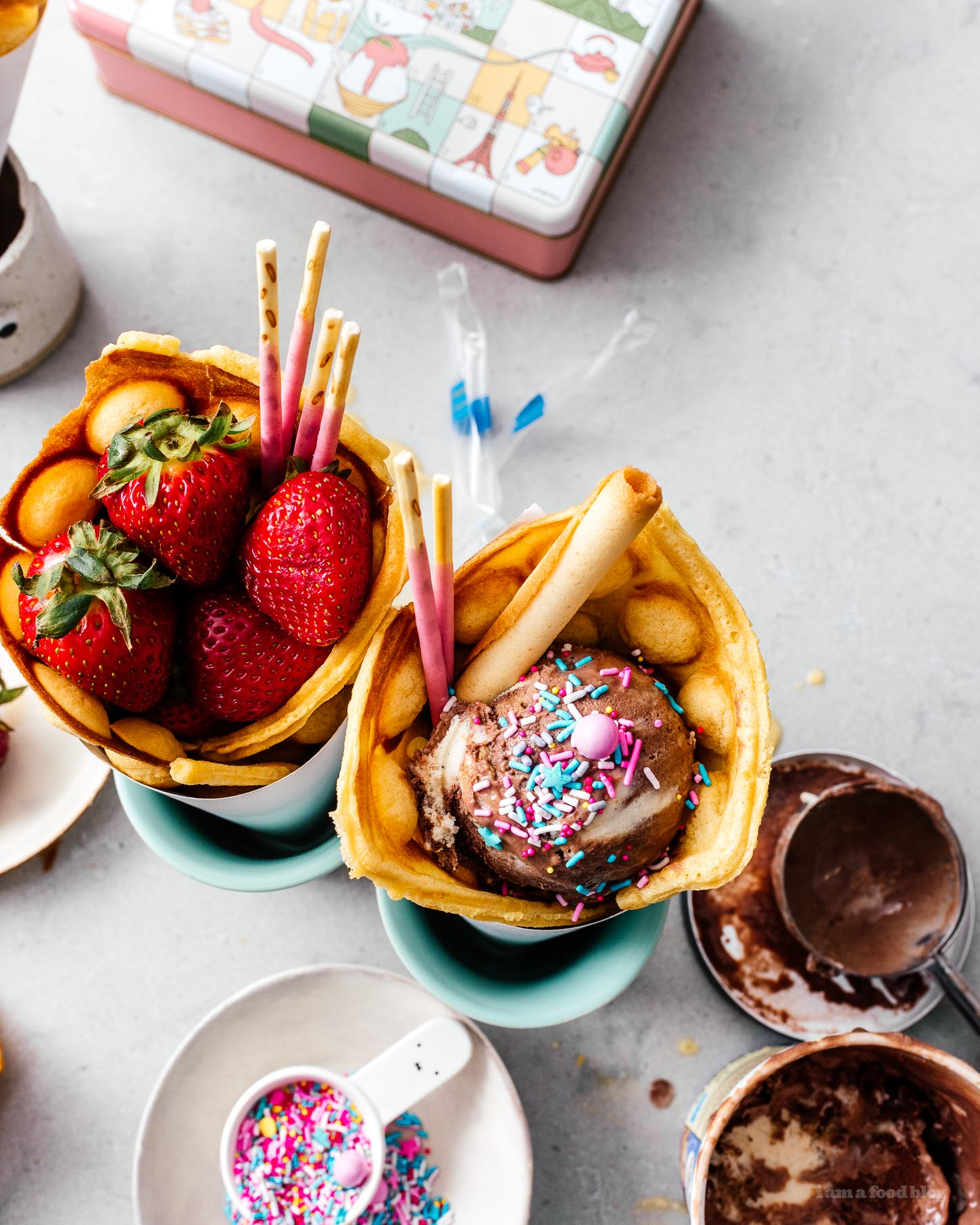 Make your own infinitely instagram friendly bubble waffle ice cream cones/puffle cones/eggloo egg waffle cones right at home. The batter comes together easily and you can fill your cones with ALL the things: ice cream, fruit, cookies, anything goes. #bubblewaffle #bubblewafflecones #hongkongbubblewaffles #pufflecone #eggloo #eggwaffle #recipes #dessertrecipes