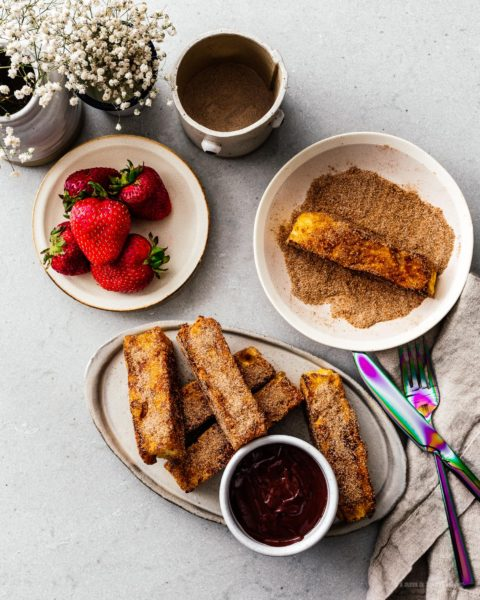 This is going to be the best French toast you'll ever eat! Cure your churro and French toast cravings with these golden brown crispy French toast sticks dipped in cinnamon and sugar. Dark chocolate dipping sauce not optional! #breakfast #brunch #recipes #frenchtoast #churros #cinnamonsugar #frenchtoaststicks