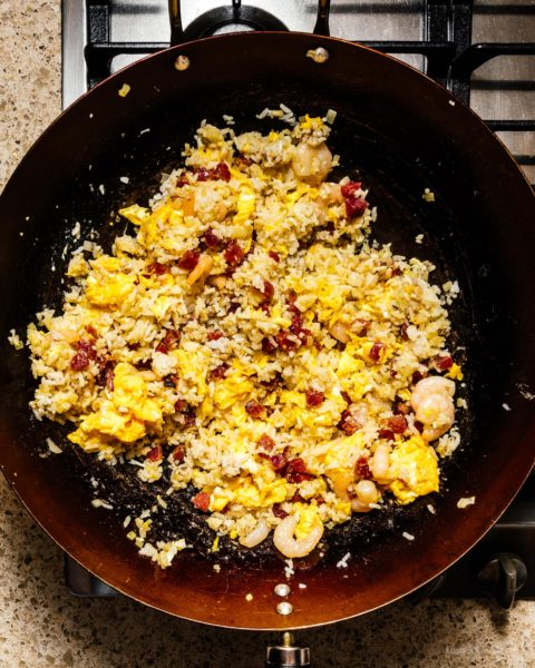 No matter what you call it: yang chow fried rice, young chow fried rice, yeung chow fried rice, or Yangzhou fried rice - there's no denying that Chinese egg fried rice is delicious. This yang chow fried rice recipe will having you making better than takeout fried rice at home in no time flat. #friedrice #friedricerecipe #chinesefood #recipes #dinner #rice #takeout #betterthantakeout