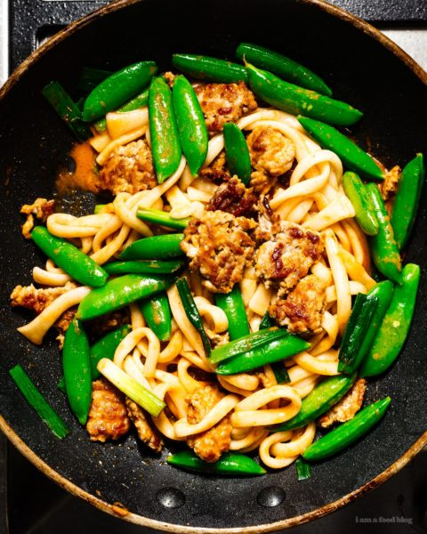 "If you're looking for a quick and easy stir fry that's full of flavor, look no further! You're just 15 minutes away from a creamy coconut curry and crispy pork udon stir fry. Minimal chopping, one pan, spicy noodle-y goodness. #stirfry #recipes #dinner #thaifood #thaicurry #weeknight"" width=""1450"" height=""1813"" class=""alignnone size-full wp-image-28846"