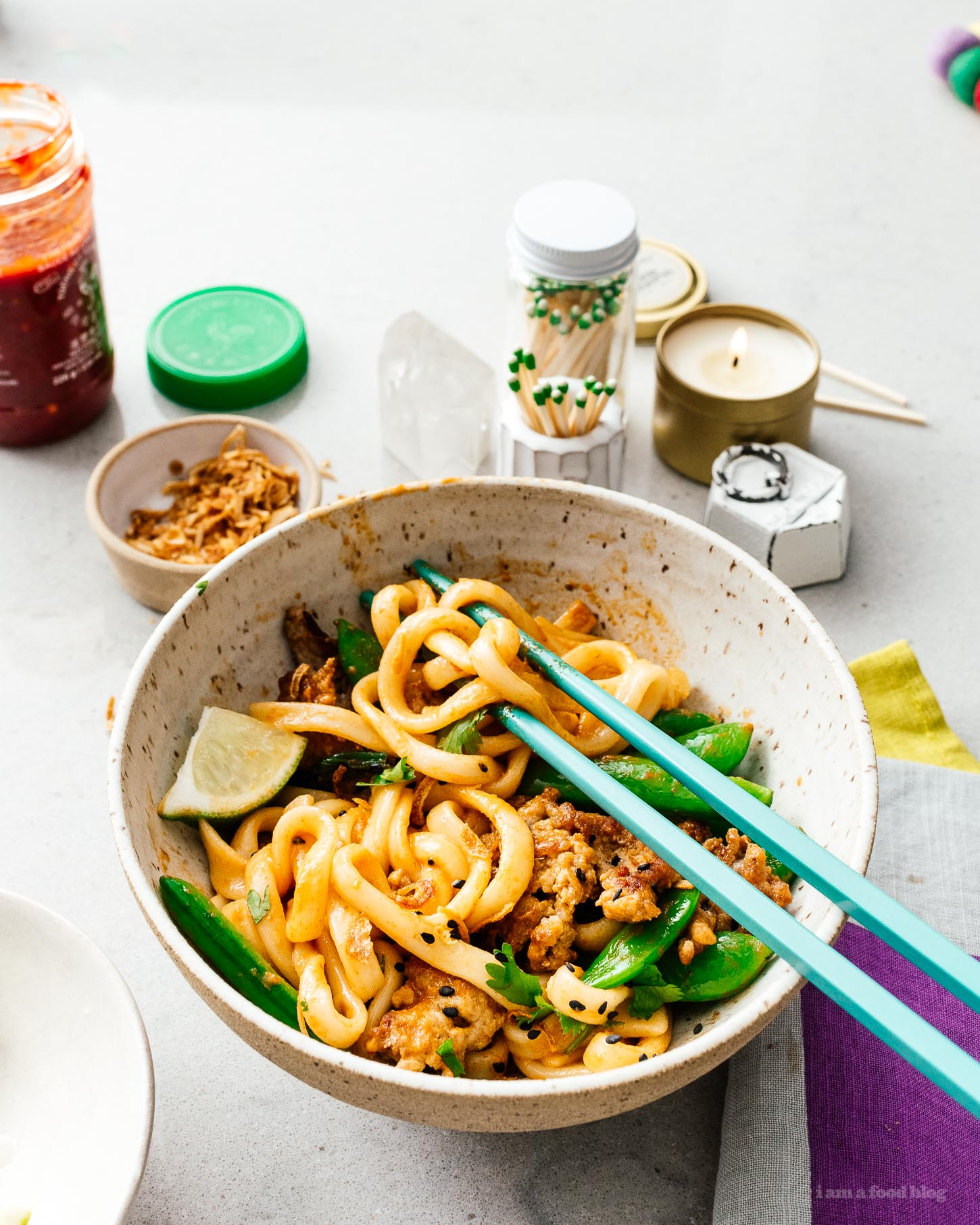 If you're looking for a quick and easy stir fry that's full of flavor, look no further! You're just 15 minutes away from a creamy coconut curry and crispy pork udon stir fry. Minimal chopping, one pan, spicy noodle-y goodness. #stirfry #recipes #dinner #thaifood #thaicurry #weeknight
