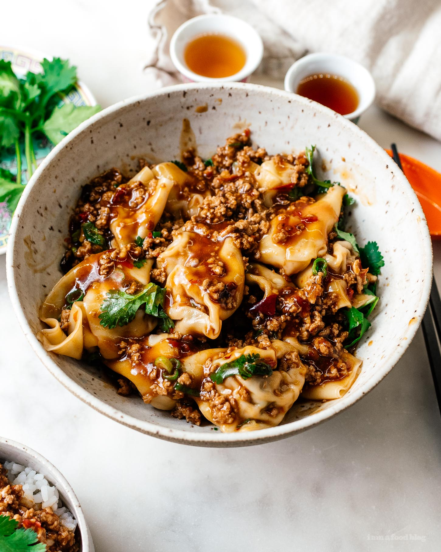 These spicy Sichuan turkey wontons in mapo sauce are a fun twist on wontons in red chili oil #wonton #sichuan #turkeywonton #turkey #spicy #chinesefood #recipes