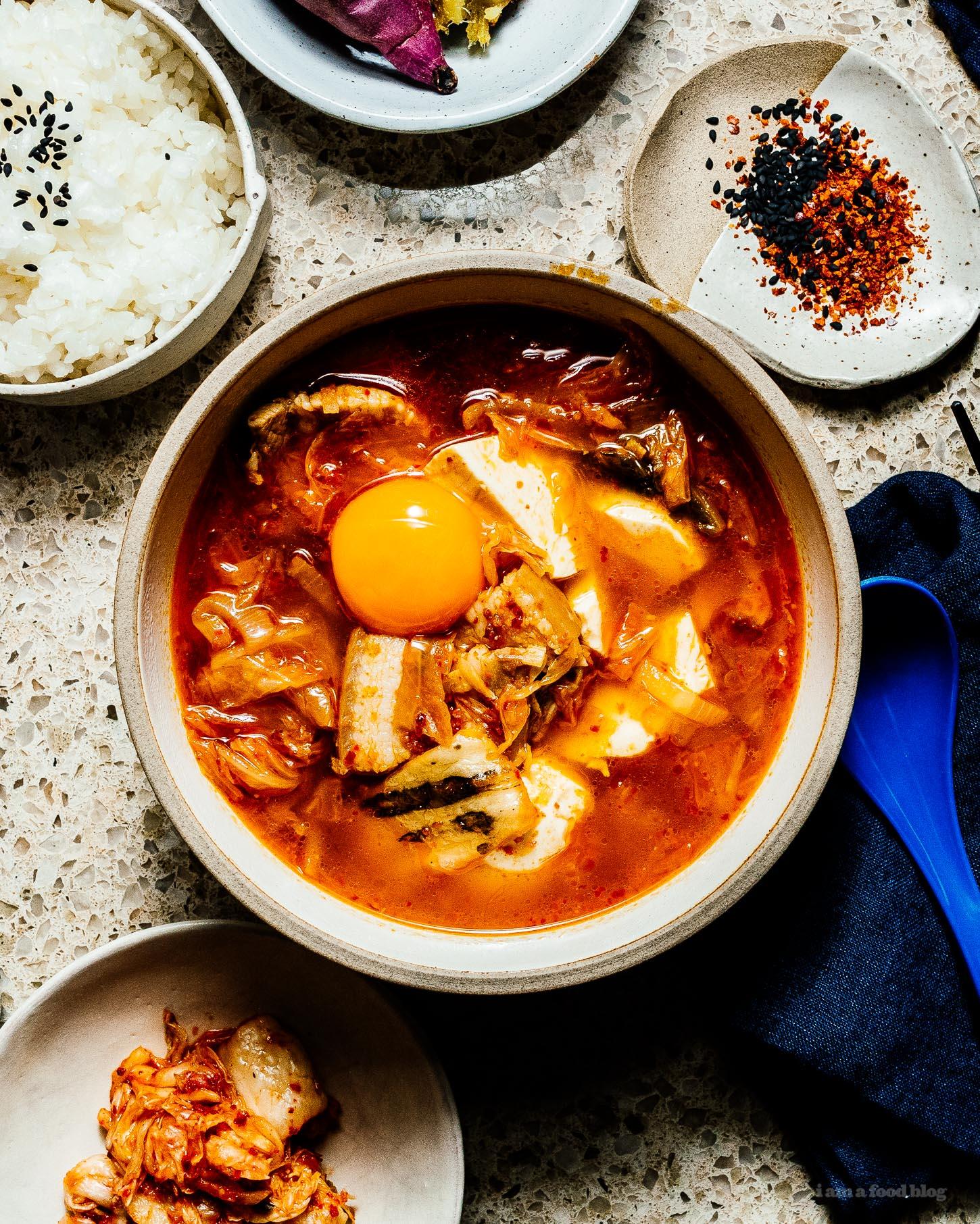 Warm and comforting sundubu jjigae/spicy kimchi soft tofu stew #kimch #tofu #korean #recipes #dinner #soup #stew #tofustew #tofusoub