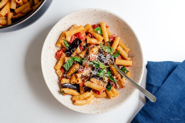 A traditional Sicilian pasta dish made with sautéed eggplant and tomatoes. Meat free, super delicious, and easy! | www.iamafoodblog.com