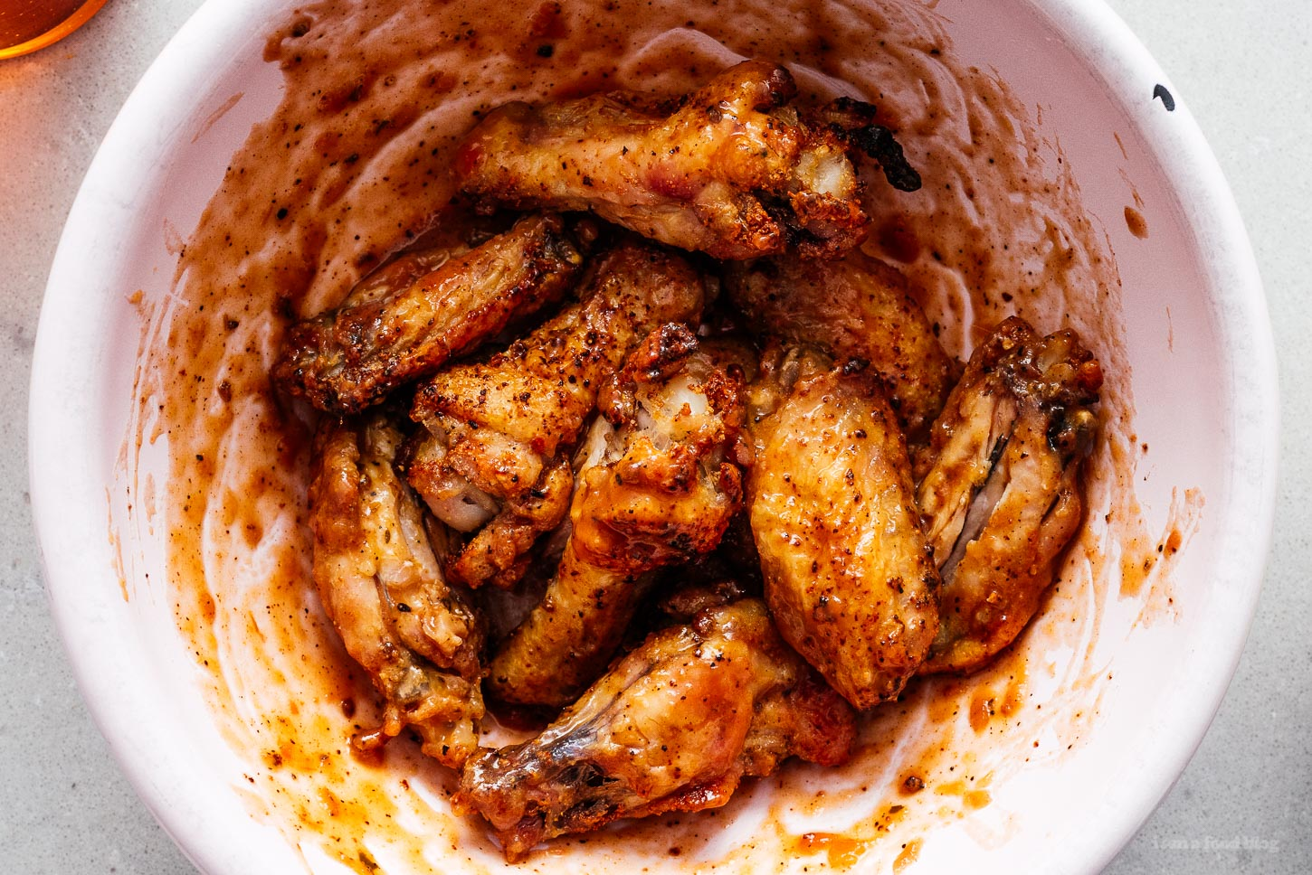 air fryer chicken wings tossed in hot sauce | www.iamafoodblog.com