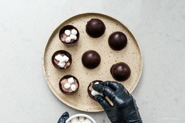 filling hot chocolate bombs | www.iamafoodblog.com