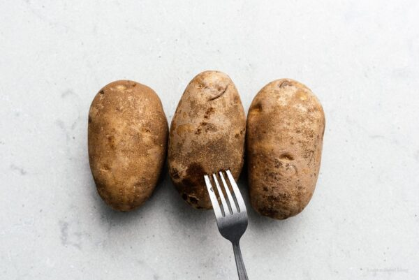 poking potatoes with a fork | www.iamafoodblog.com